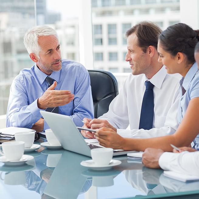 Business Meeting Surrounding A Computer