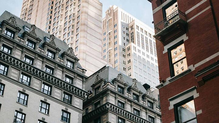 A mid level view of a three high rise buildings