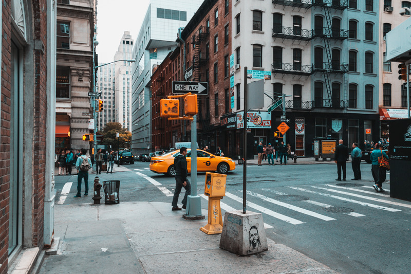people crossing city street